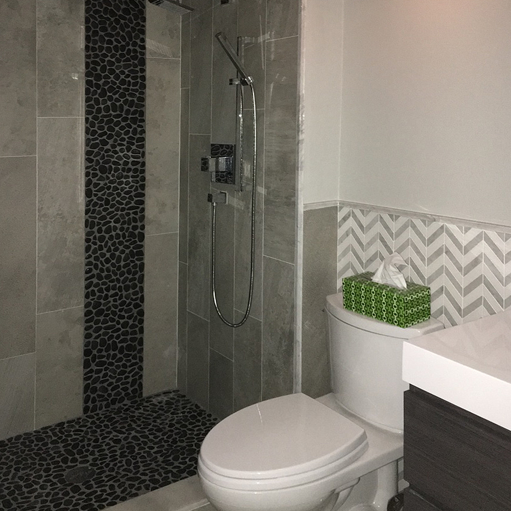 Glazed Black Pebble Tile Shower Floor and Accent