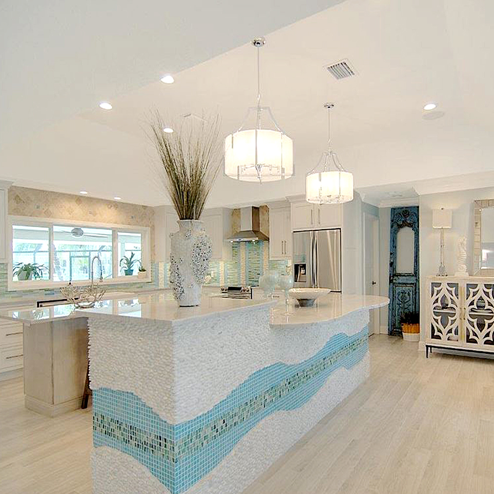White Standing Pebble Tile Kitchen Island and Backsplash