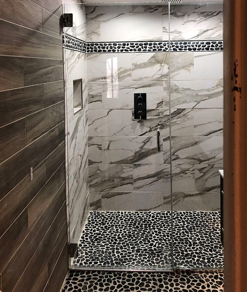 Polished Black Pebble Tile Shower