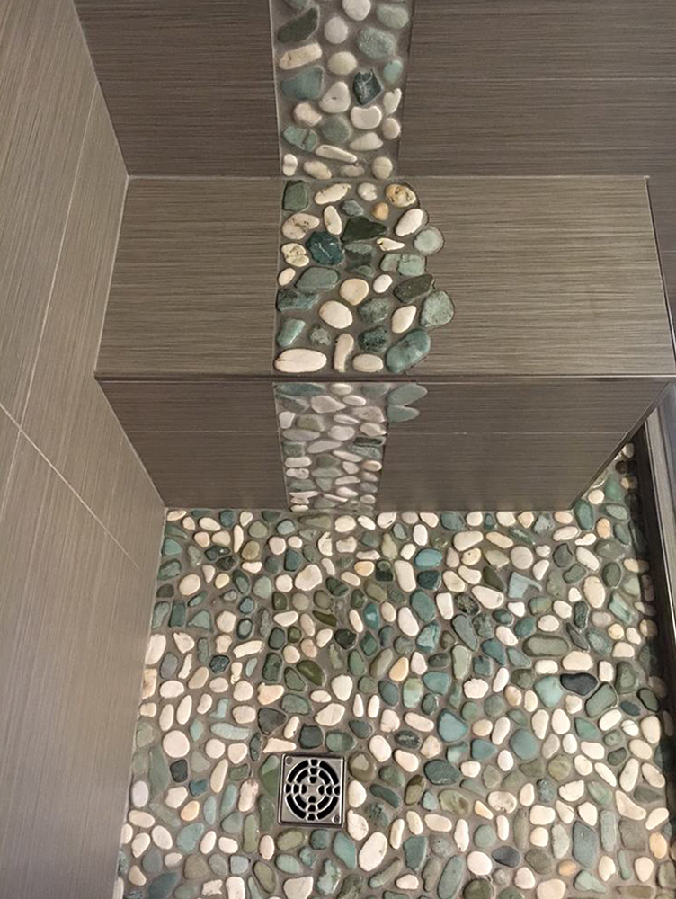 Sea Green and White Pebble Tile Shower Basin with Unique Accent Strip