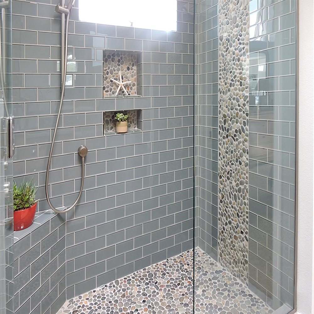 Ocean Glass Subway Tile Shower Featuring Pebble Tile
