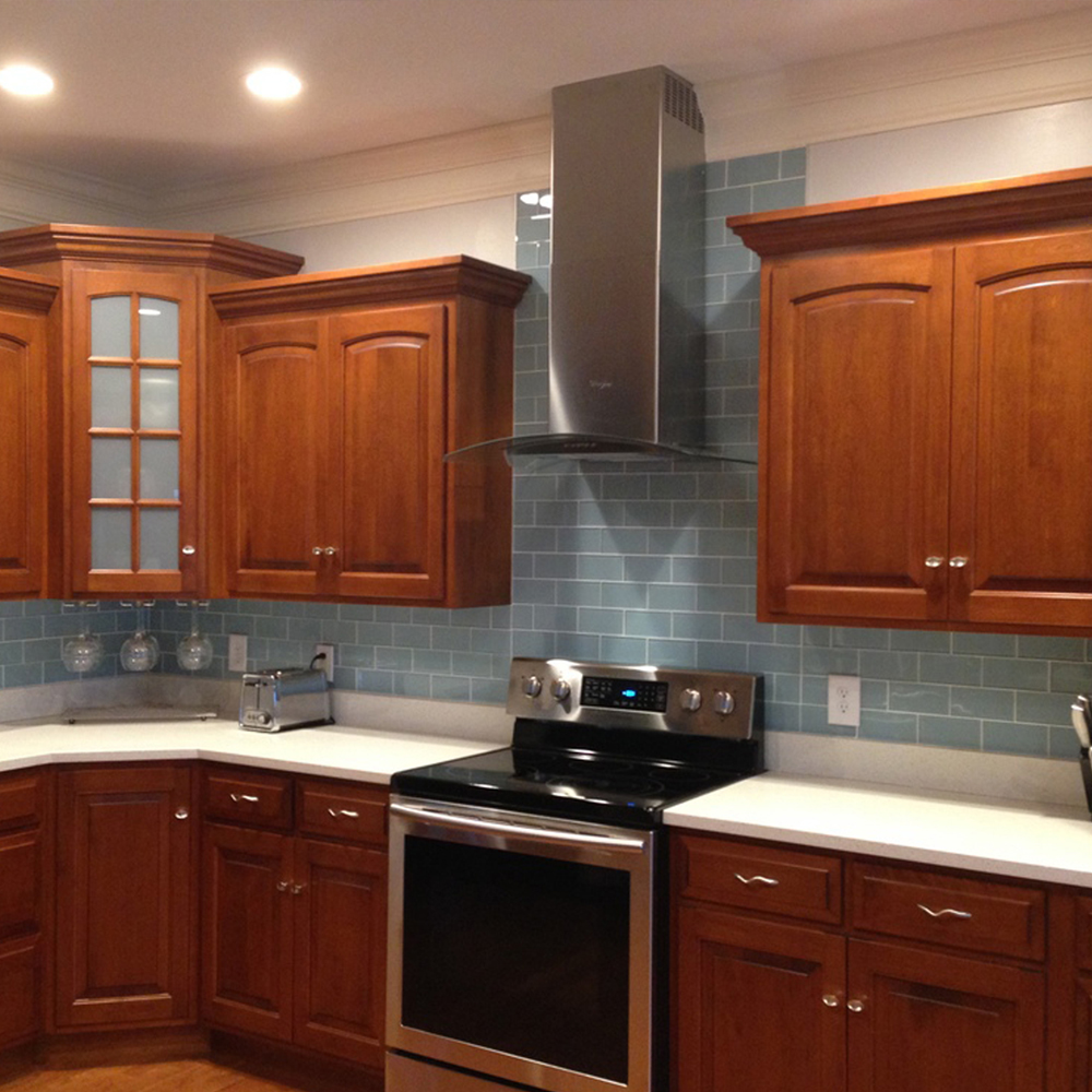 Vapor Glass Subway Tile Kitchen Backsplash with Wood Cabinets