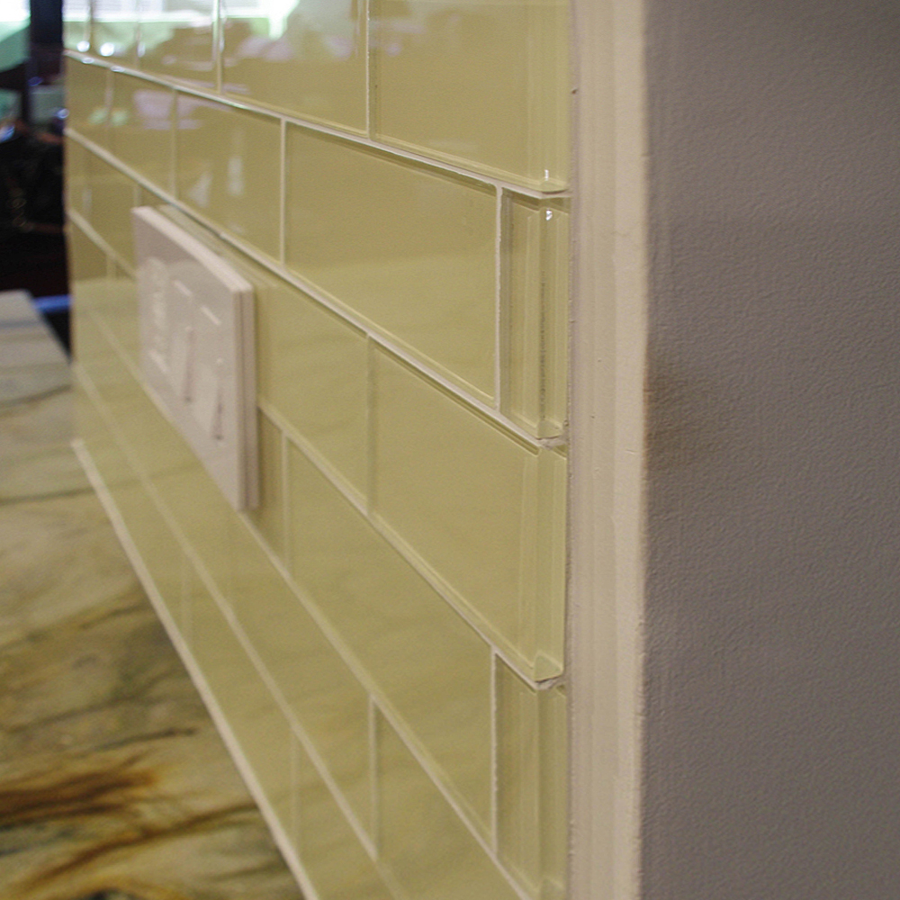 Cream Glass Subway Tile Wall Edge Close Up