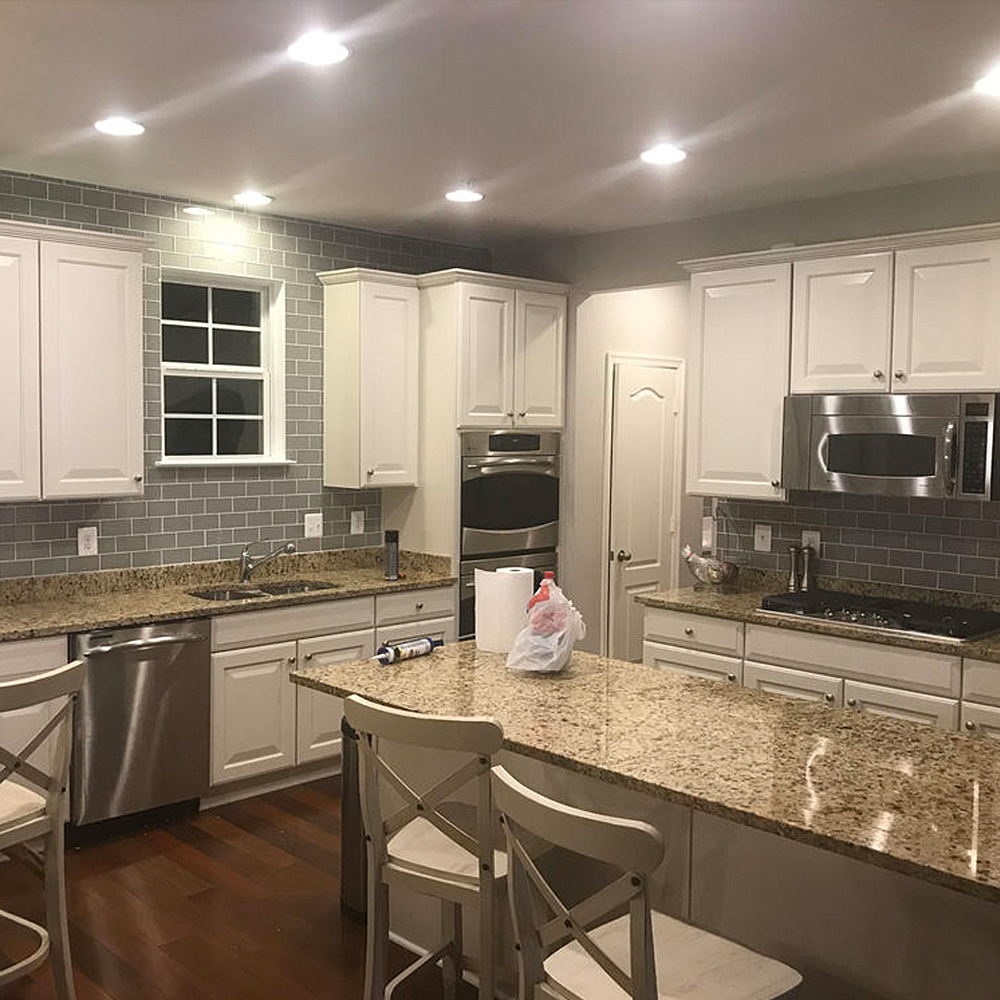 Complete Kitchen Renovation with Smoke Glass Subway Tile Backsplash