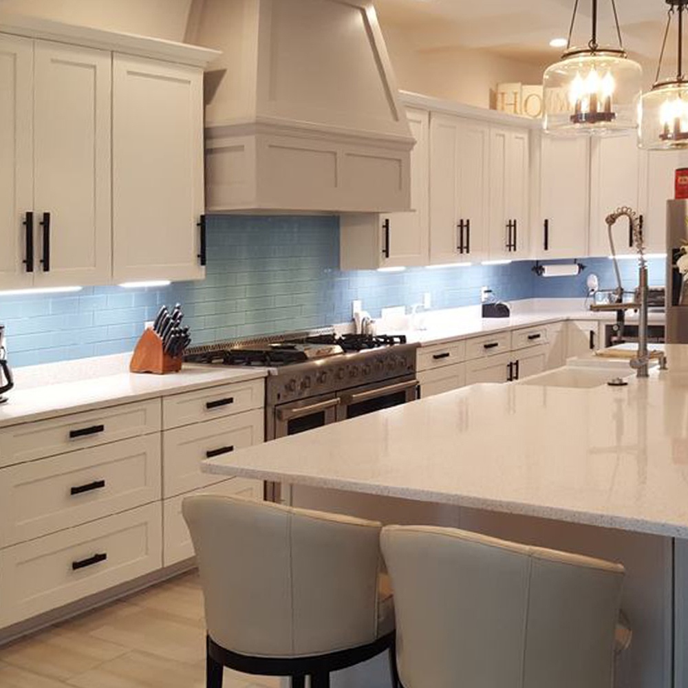 Sky Blue Glass Subway Tile Backsplash in Clean White Kitchen