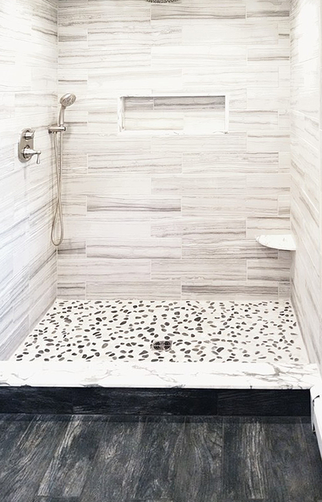 Black and White Pebble Tile Shower Pan