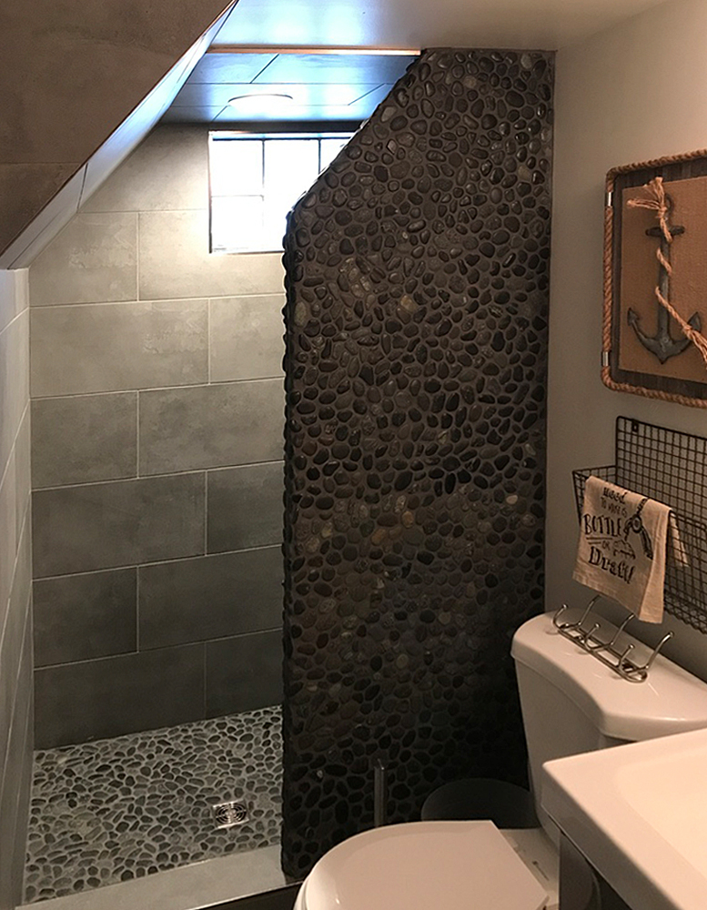 Black Pebble Tile Shower Floor and Wall