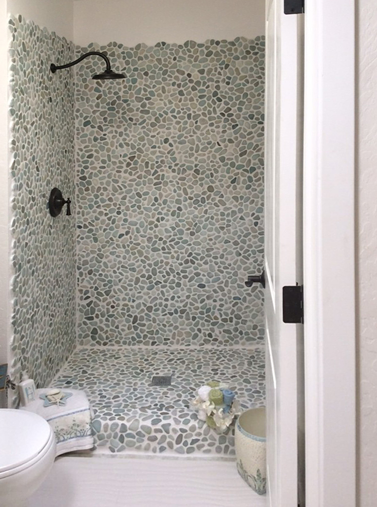 Sea Green and White Pebble Tile Shower