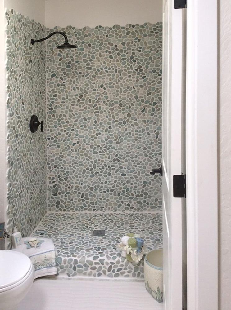Sea Green and White Pebble Tile Shower