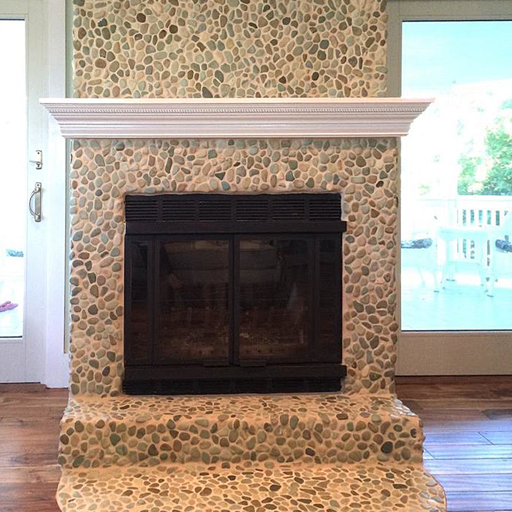 sea green pebble tile fireplace surround and hearth