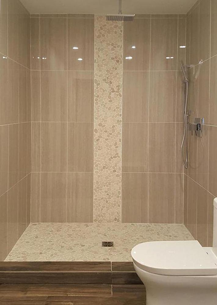 Sliced White Pebble Tile Luxury Shower