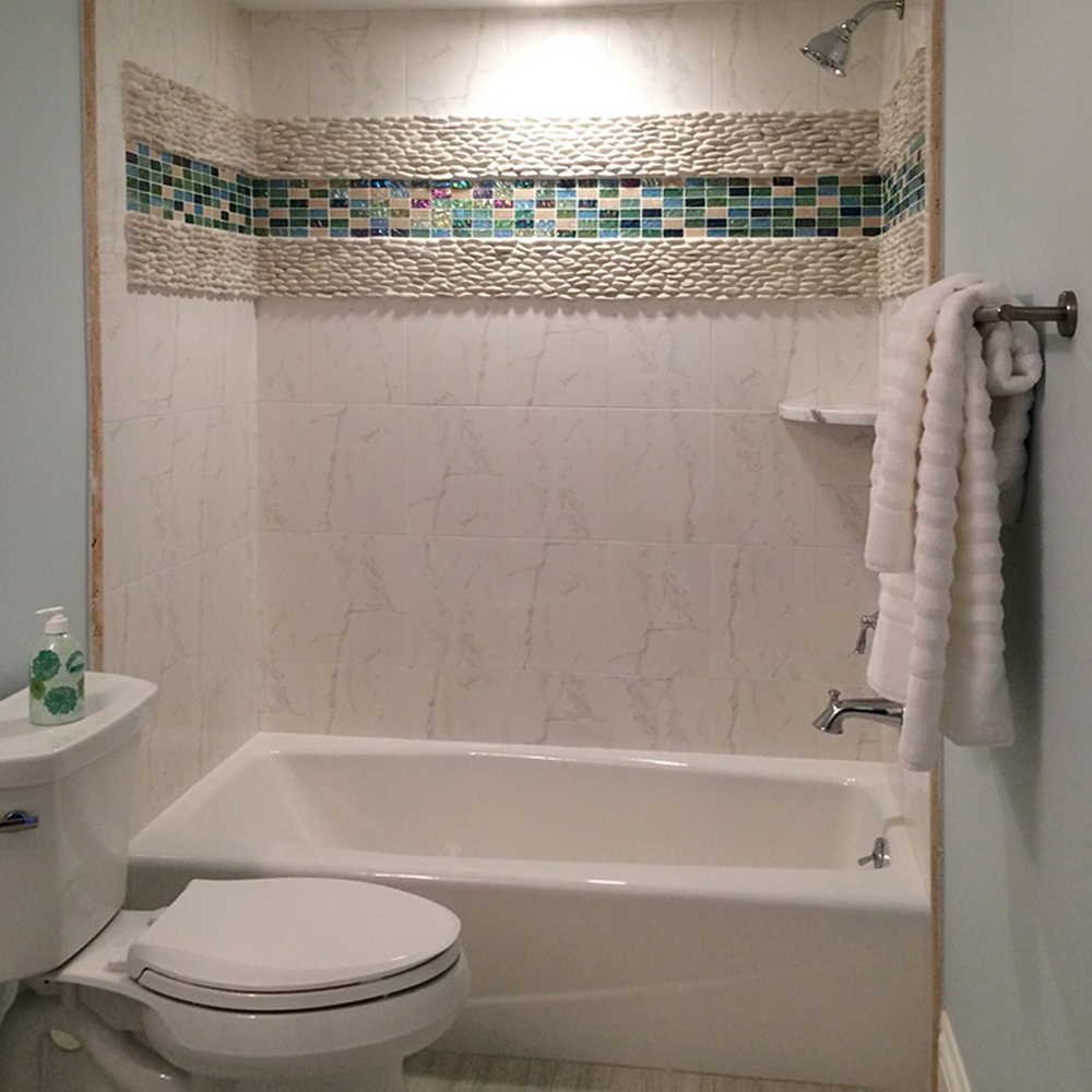 Standing White Pebble Tile Shower Accent