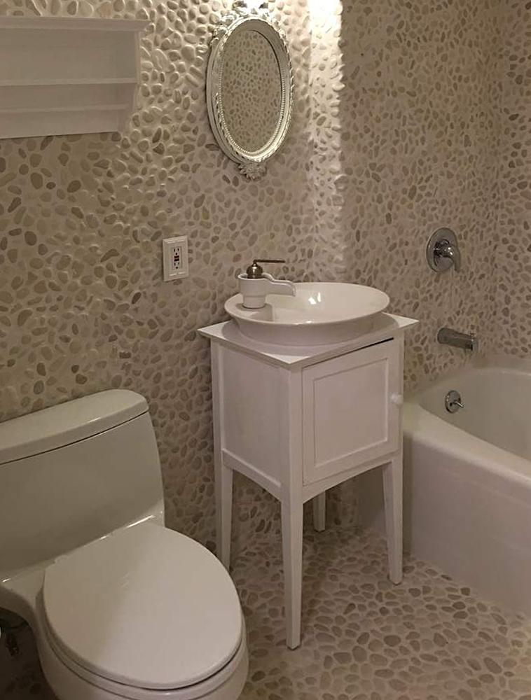 White Pebble Tile Bathroom Floor and Walls