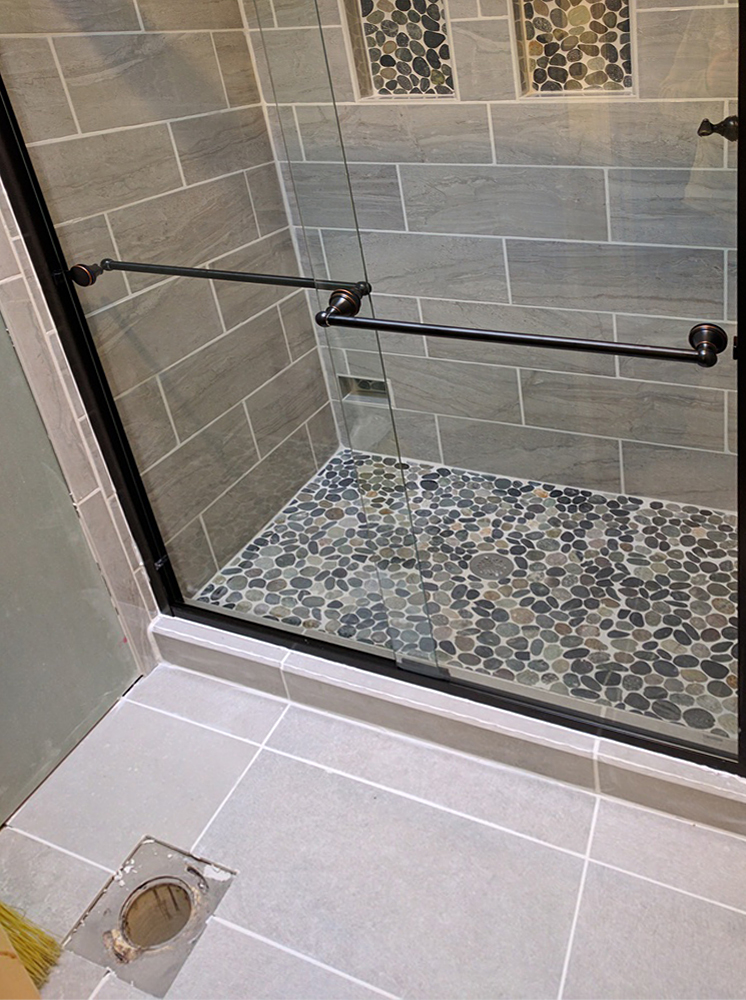 Sliced Bali Ocean Pebble Tile Shower Floor and Niche Accent