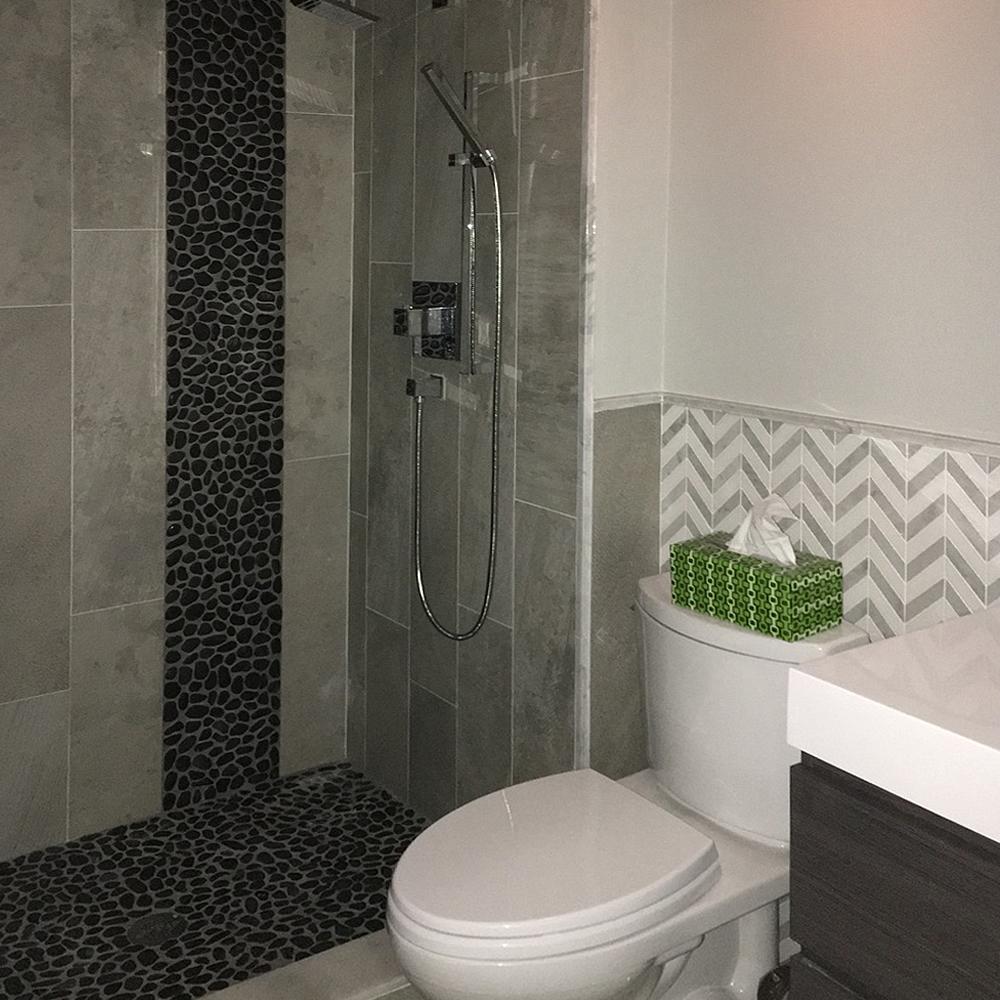 Glazed Black Pebble Tile Shower Floor and Accent