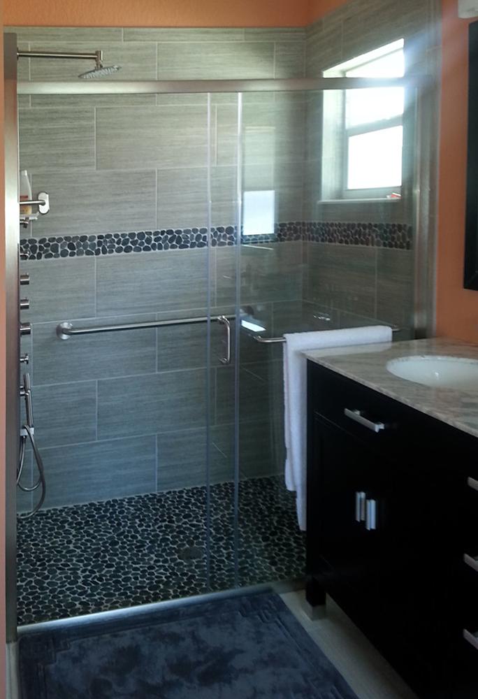 Sliced Black Pebble Tile Shower Floor and Border