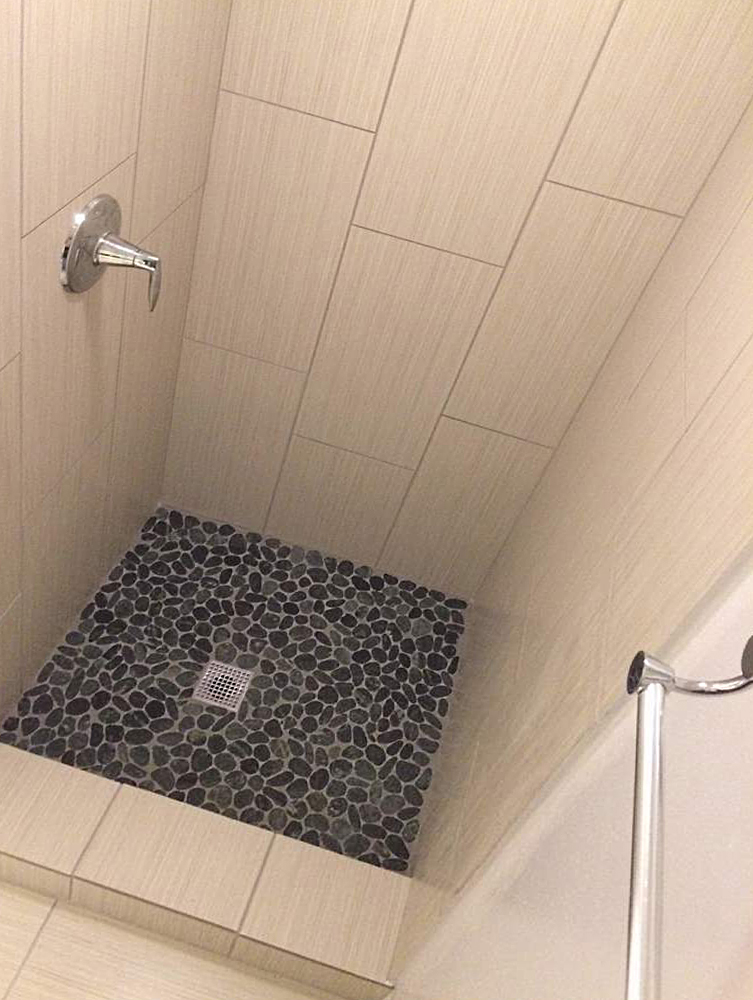 Sliced Charcoal Black Pebble Tile Shower Floor