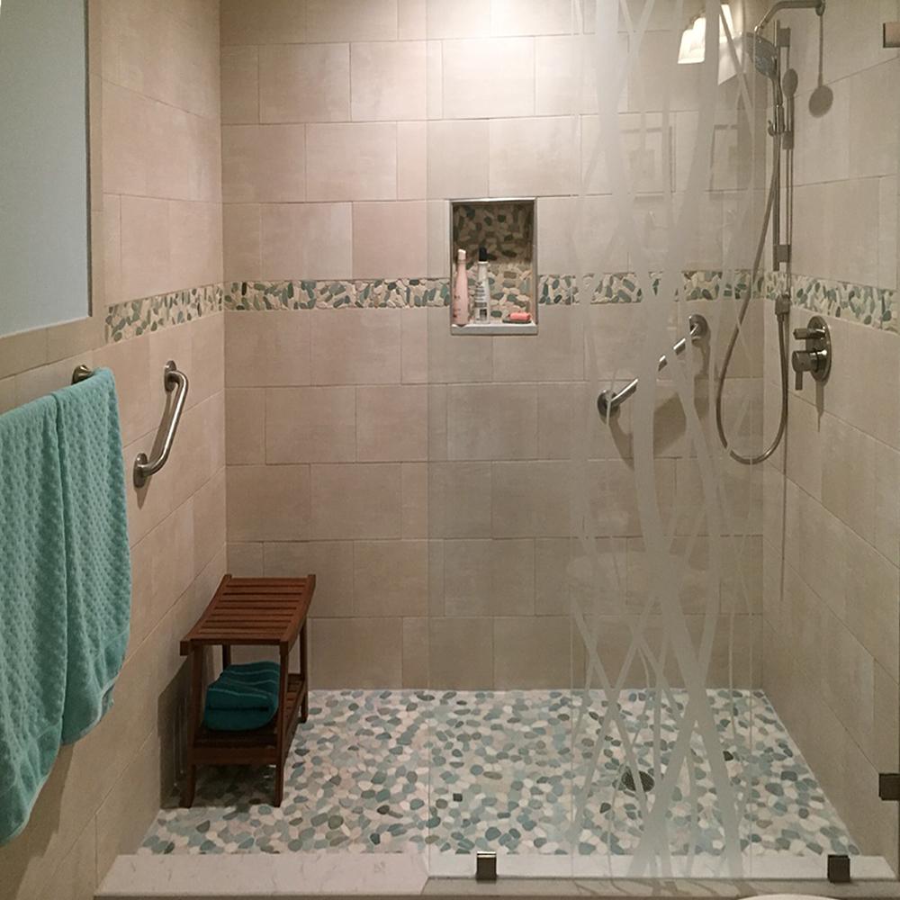Sliced Green and White Pebble Tile Shower Floor and Border Strip