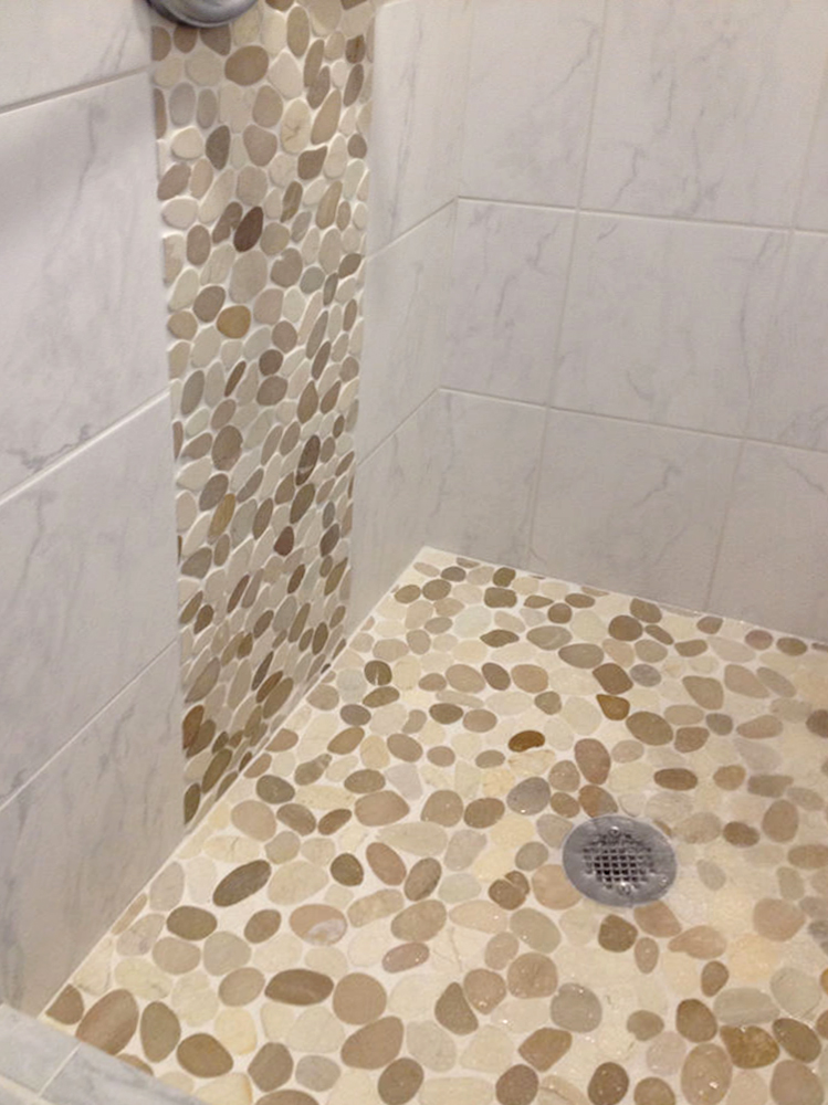 Sliced Java Tan and White Pebble Tile Shower Waterfall