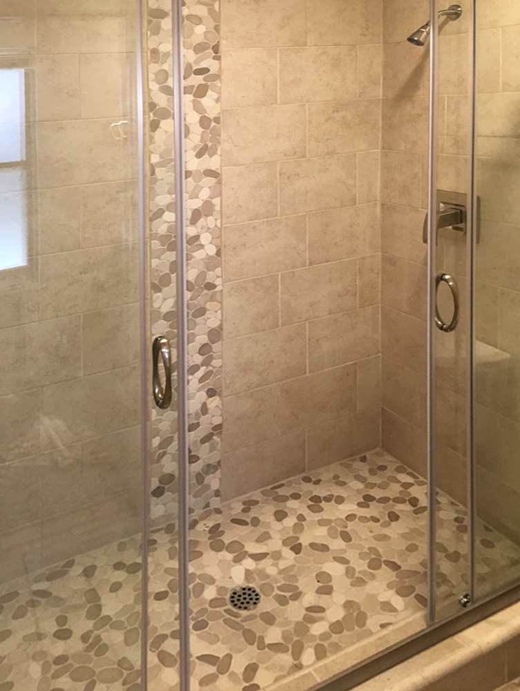 Sliced Tan & White Pebble Tile Shower Floor and Accent