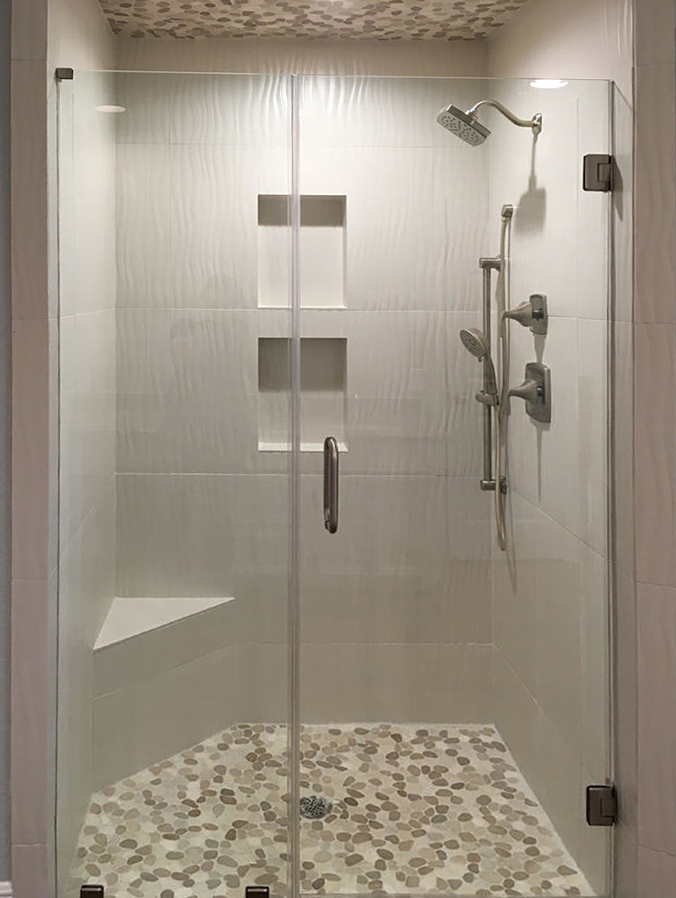 Sliced Tan and White Pebble Tile Shower Pan and Ceiling