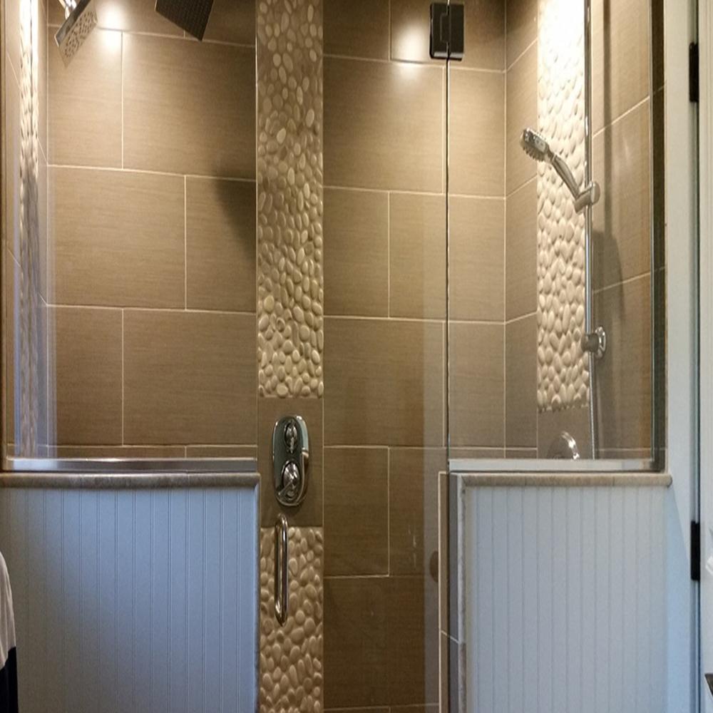 Tan Pebble Tile Shower Floor & Accents