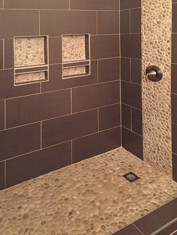 Tan Pebble Tile Shower Floor with Accents