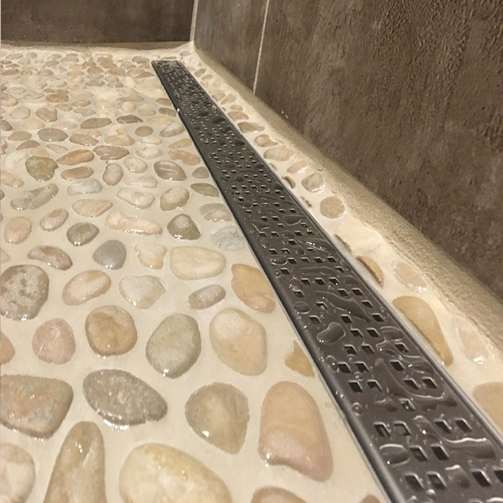 Java Tan Pebble Tile Shower with Modern Grate Drain