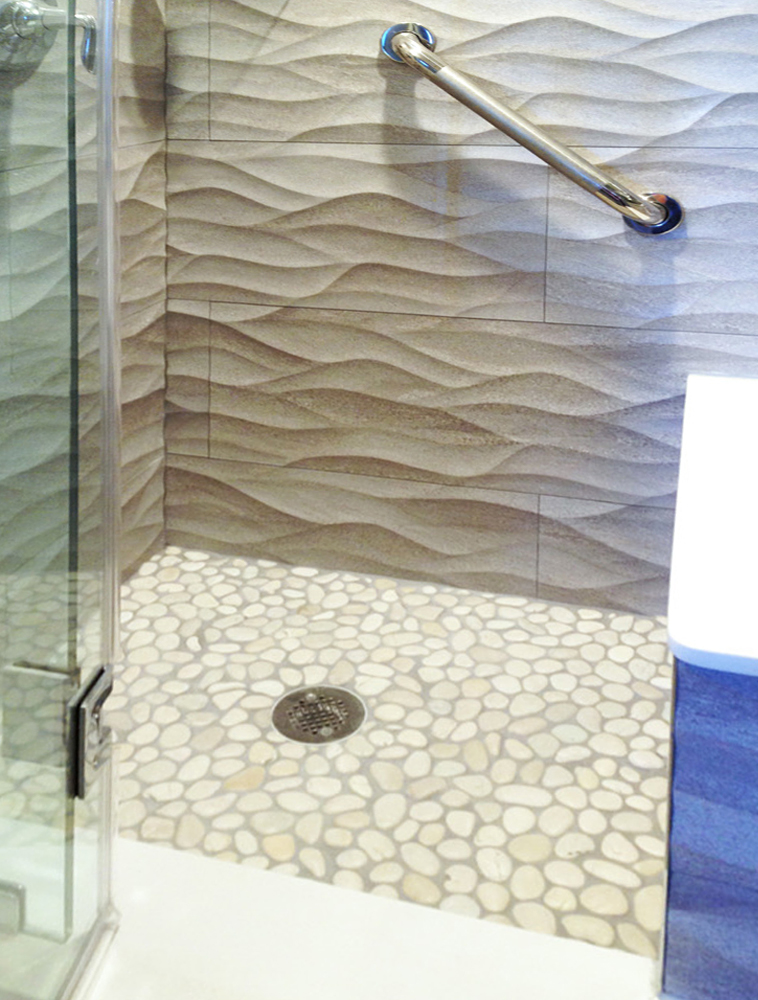 White Pebble Tile Shower Floor with Textured Walls