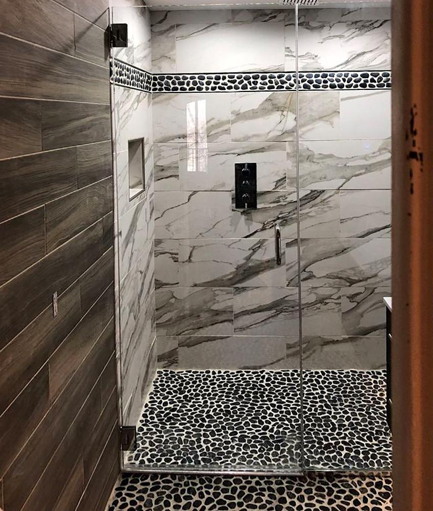 Polished Black Pebble Tile Shower