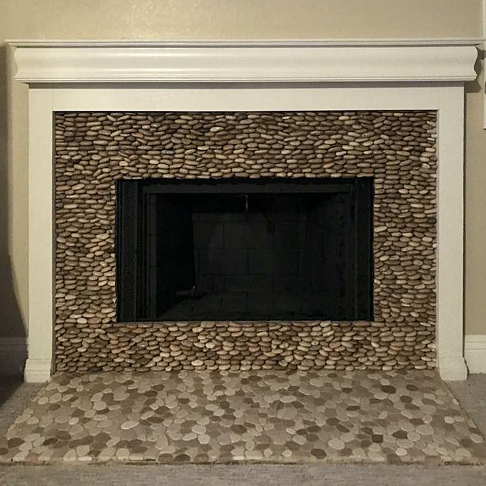 Tan Pebble Tile Fireplace and Hearth