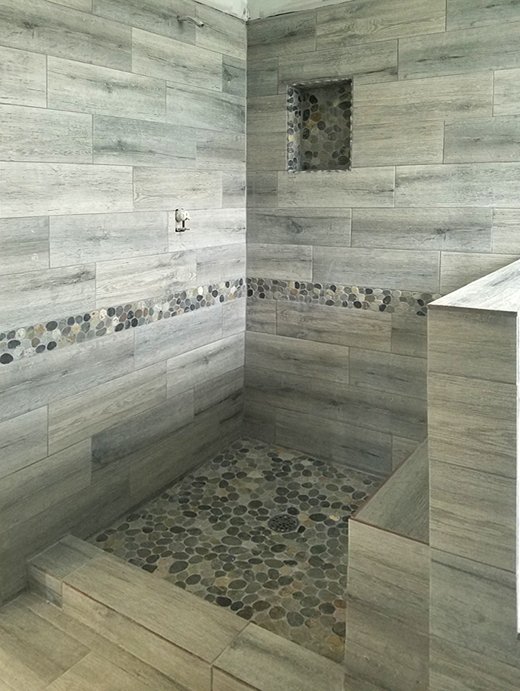 Sliced Bali Ocean Pebble Tile Shower Floor with Accents