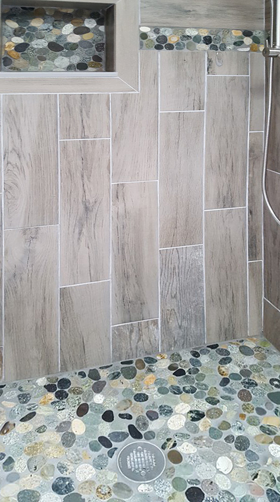 Sliced Bali Ocean Pebble Tile Shower Floor with Niche