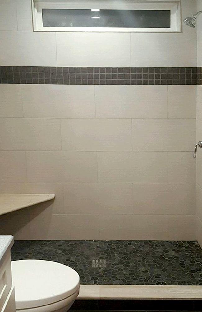 sliced-black-pebble-shower-flooring