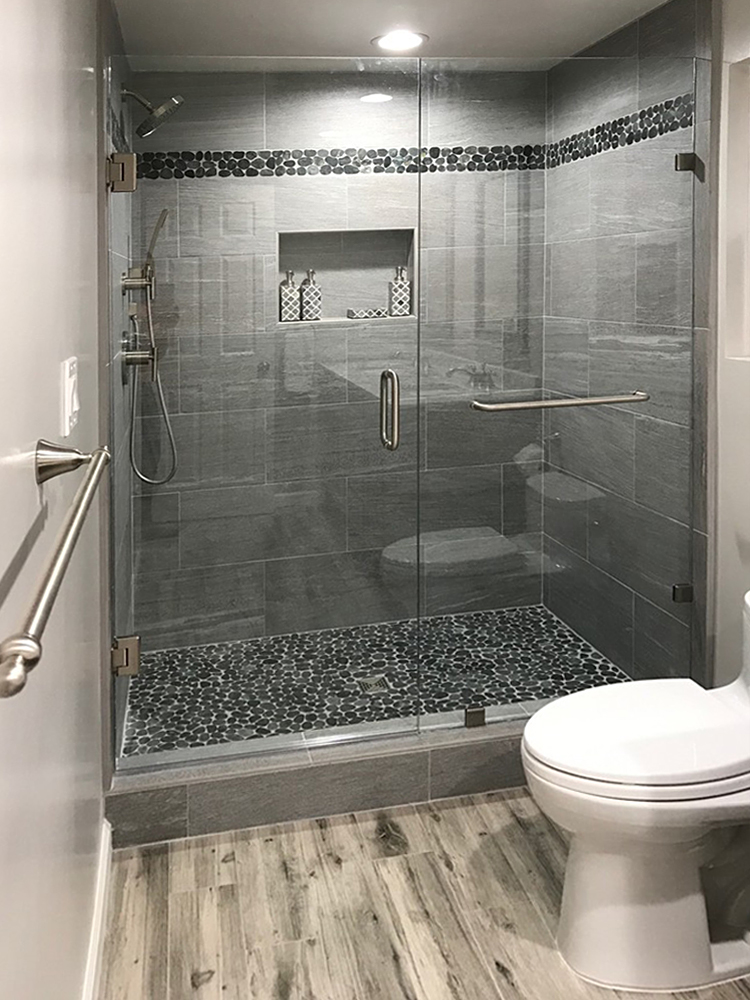sliced-black-pebble-tile-shower-pan-and-border