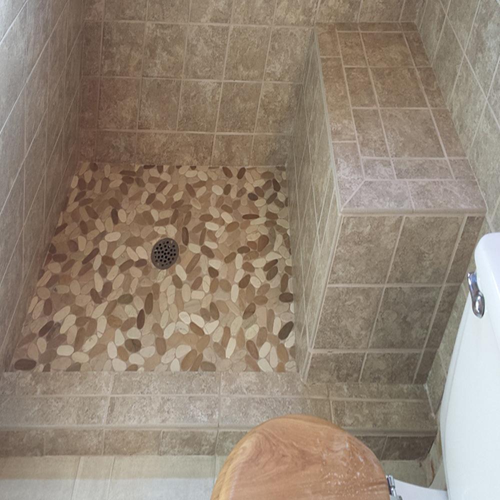 Sliced Tan and White Pebble Tile Shower Pan