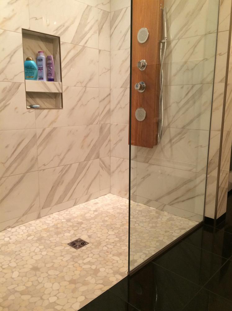 Sliced White Pebble Tile Shower Floor