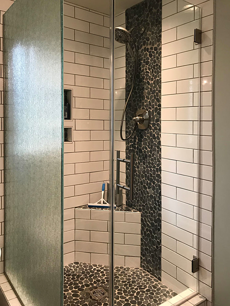 Sliced Charcoal Black Pebble Tile Shower Floor and Accent