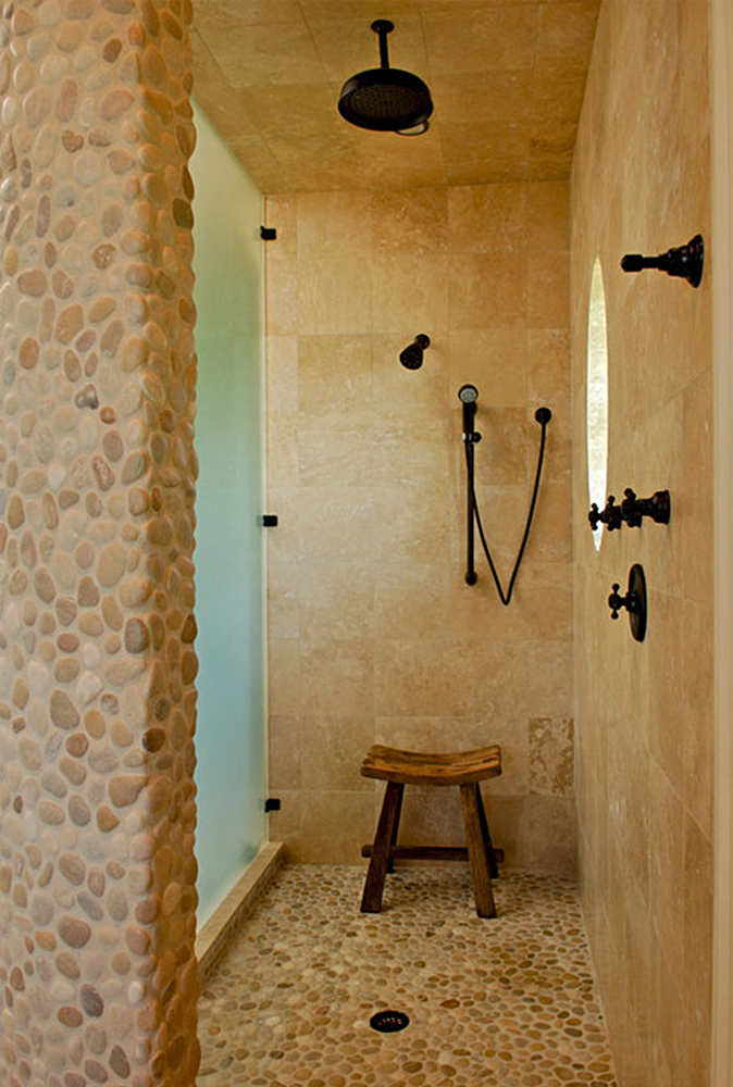 tan-and-white-pebble-tile-shower-floor-and-accent