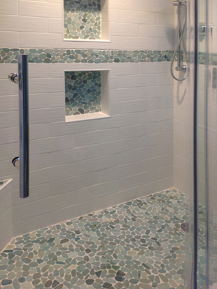 Sliced Sea Green Pebble Tile Shower Floor and Niche