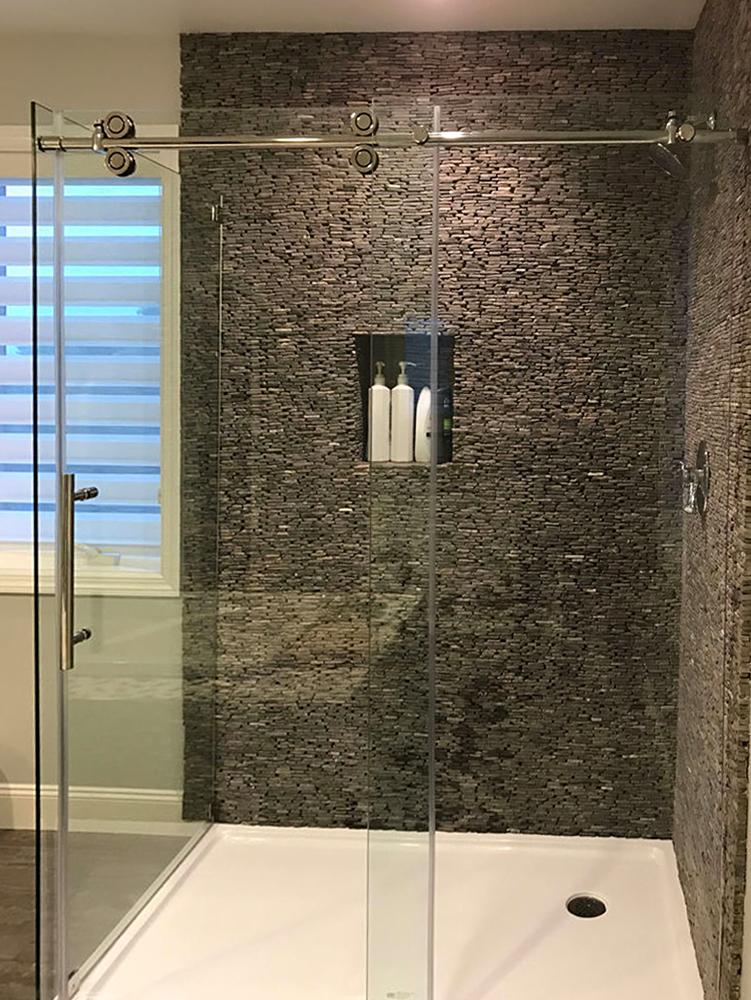 standing stone mosaic shower wall
