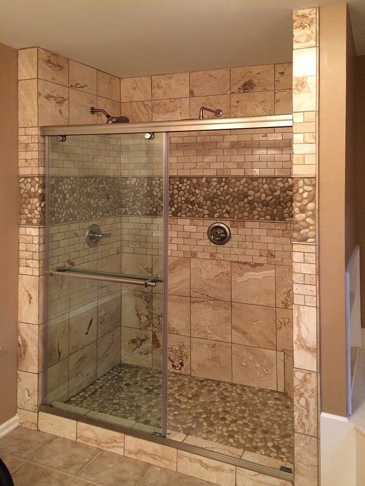 Glazed Java Tan & White Pebble Tile Shower Floor & Walls